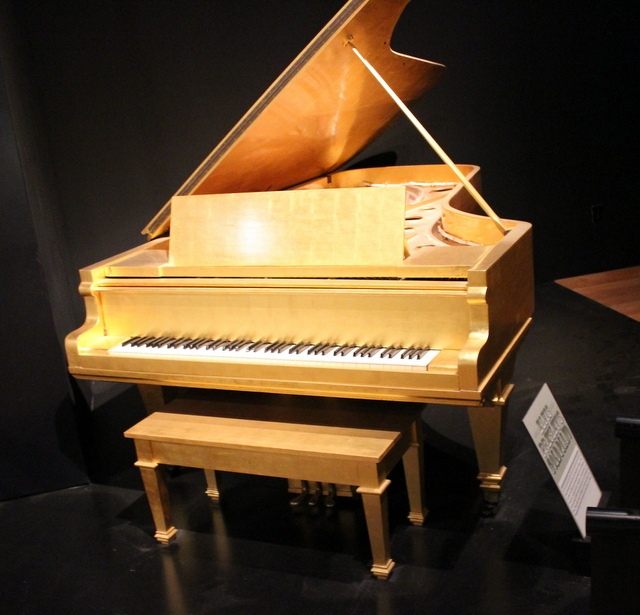 Elvis Presley's gold piano. Priscilla presented this to Elvis in 1968 to commemorate their 1st Anniversary. A 1928 Kimball grand piano in 24-karat gold leaf.