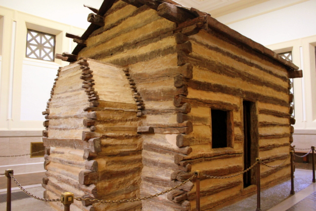 The symbolic Lincoln cabin enshrined in the Memorial.
